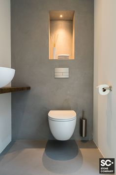 Storage over toiletStorage over toilet ideas for the smallest room in the house!Toilet Inspiration Trend ColorToilet room The Hague (Stone Company)Nice slim toilet with a concrete circle. The toilet and the fountain are matt Small Toilet Design, Small Toilet Room, New Toilet, Modern Toilet Design, Bathroom Styling, Bathroom Interior Design, Modern Bathroom, Small Bathroom, Downstairs Toilet