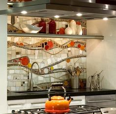 Love this idea.... Mural as a backsplash for your cooker!