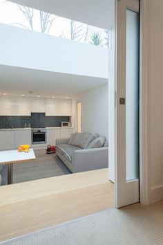 This attractive basement extension in London is focused around an oak staircase