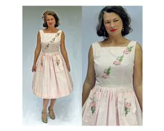 1950s dress in light pink by Bunny Casuals of Miami.  Embroidered rose appliqued on bodice with square neck. Two big patch pockets each with