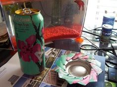 Beautiful ashtrays from cans! should've used it in the hostel...can actually even become decorative flowers!