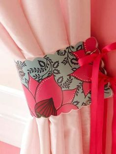 diy curtain tie backs. Use pretty paper, scallop the edges, laminate, cut out, punch holes, ad grommets, use ribbons to hold the tiebacks into place.