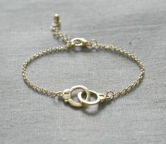 Delicate simple everyday handcuff gold bracelet. $14.00, via Etsy.
