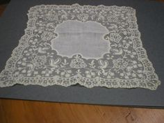 "Archive photo: 1870 lace and linen wedding handkerchief. Linen center with 4"" lace border with scalloped edge. Gift of Annie G. Chase. Object ID: X.9237.001.001. As seen in the Music Room of the Historic Atwood House, Chatham, MA.  #lace, #handkerchief, #atwoodhouse, #chathamhistoricalsociety, #chatham, #capecod"