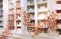 Great diy idea for your reception location! Make the butterflies/flowers ahead of time, and have your planner/assistant stick them on the wall on the day of!