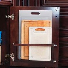 Kitchen decor, Kitchen designs, Kitchen decorating ideas - Cutting board holder that hides behind a base cabinet door. #clever