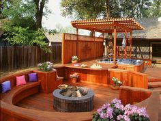 A pergola for shade and an adjacent fire pit are just two of the added features for this California spa. Built-in seating completes this user-friendly backyard. Photo courtesy of California Redwood Association