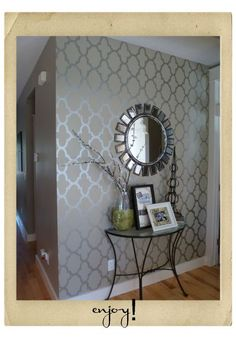 interesting way of highlighting an entry way into a home without a defined entrance hall.    I'm totally into the stenciling!!