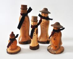 Too often snowmen are only shown having Top hats. I like the variety of hat shapes here.