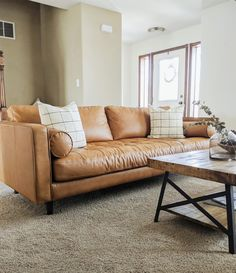 I'm sharing my honest thoughts on our leather couch including best cleaning tips and how it's held up to wear. We've had this leather sofa in our living room for 2 years with a large dog! Pin these modern leather couch tips for later! Tan Leather Sofas, Modern Leather Sofa, Modern Couch, Living Room Modern, Living Room Sofa, Living Room Furniture, Living Room Designs, Living Room Decor, Leather Lounge