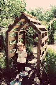 Forklift pallet garden arbor. Stain a dark color or paint white. Maybe grow some beans or grapes onto it.