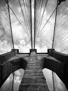 ARTFINDER: Brooklyn Bridge #1. New York, NY by Cameron R Neilson - Avoiding the heavy foot traffic, bicyclists, and subtly shaking boardwalk of the bridge made this image a challenge. I spent about over an hour waiting for ...