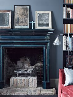 The focal point in the living room is a beautiful, reclaimed, blue glazed ceramic, Art & Crafts fire surround - Camden House Design Project Paint Fireplace, Black Fireplace, Home Fireplace, Fireplace Surrounds, Fireplace Design, Fireplace Mantels, Fireplaces, Bedroom Fireplace, Mantles