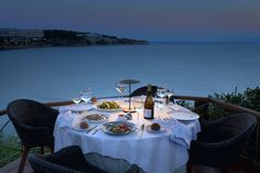 Spectacular dinner setting by the sea at Ithaki Restaurant, Athens, Greece