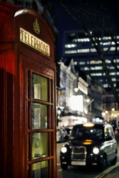 London calling. Old red telephone booth.
