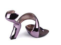 Shoes made from a single strip of plastic, formed as shoes around feet.  Great Britain. 2012