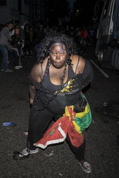 Bloedneuzen, ballonnetjes en daggeren: foto's van het Notting Hill Carnival