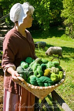 Green yarn in basket held by Karen Clancey; weaver and dyer for the Colonial Williamsburg Foundation Photo by Barbara Temple Lombardi