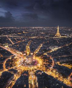 Paris is the City of Lights, and you can really tell in this beautiful night aerial shot, including the wagon wheel of roads surrounding the Arc de Triomphe and the iconic Eiffel Tower in the distance. Source by theglobalgadabout Tour Eiffel, Torre Eiffel Paris, Travel Qoutes, Aerial Photography, Travel Photography, France Photography, Photography Lighting, Eiffel Tower Photography, Landscape Photography