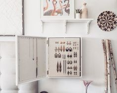 Love the idea of the swinging peg board Wall Mounted Jewelry