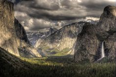 Mountains streaked with mystique. Yosemite on a cloudy day by Michael Flick