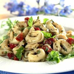 Garlicky pesto and rich sun-dried tomatoes make this tortellini irresistable. This is an easy dish for a picnic or potluck. A salad and loaf of bread will complete this meal.