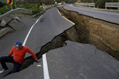 A man climbs out of a crack after taking some pictures of a section of highway that collapsed in Chacras, Ecuador, on April 19. The strongest earthquake to hit Ecuador in decades flattened buildings and buckled highways along its Pacific coast, sending the Andean nation into a state of emergency. Rodrigo Abd / AP