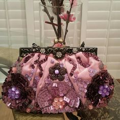 Beaded special occasion purse/clutch Brand new with tags Beaded flower design Also Comes with longer attachable strap Can be used as a clutch  Perfect for spring wedding Bags Clutches & Wristlets