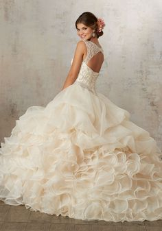 313562e11c Quinceañera Dress Featuring a Cascading Ruffled Organza Skirt and Jewel  Beaded Corset Bodice. Matching Stole
