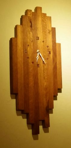I made this in the 80s when I had after hours access to the machine shop at the factory I worked at. I cut equal width pieces of oak from main pallet ribs. I used the same stain(Probably Minwax, unknown color) on all pieces. The color variations were in the wood itself. I cut them to different... #PalletClock, #PalletDecoration, #RecycledPallet