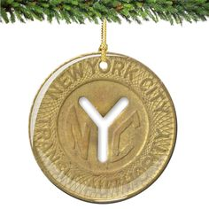 Enjoy your memories of New York City with this great keepsake, a Subway Token Porcelain Christmas Ornament. (http://www.nycwebstore.com/nyc-subway-token-porcelain-christmas-ornament/)