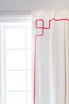 DIY'd Greek Key drapes - using simple white IKEA curtains and grosgrain ribbon!
