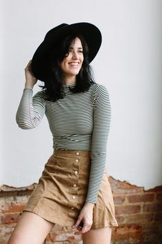 FINAL SALE: Cannot be exchanged or returned Sweet, but ever so cool. The Maggie May suede skirt features a perforated suede fabric, button up front, and high waist skater skirt cut. Rock it with boots