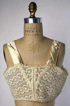 DeBevoise 1917 American. Brasserie made of Ivory cotton lace and silk straps. *vintage leavers*