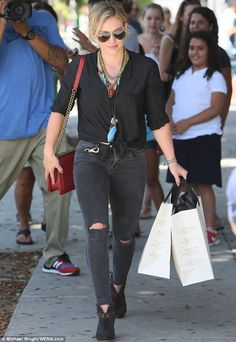 Taking it well: Hilary Duff put out a Twitter blast on Friday announcing that her new album would not be out in October as planned, before going shopping at the Curve boutique on Robertson Blvd in West Hollywood