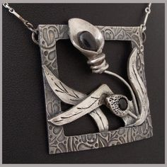 "Pendant | Victoria Banner of VixenWare.  ""Still life with orchid"".  Fine silver (PMC)"