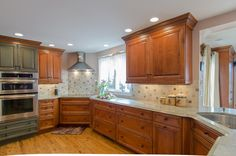 Kitchen Remodel - two toned kitchen, corner cooktop, granite countertop, corner sink, seating for four
