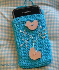 crochet mobile case. Very cute use of buttons. Inspiration only.