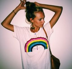 graphic tee // rainbow on a white tee // leather purse // messy bun //