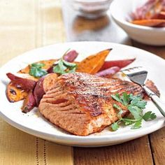 Ancho Glazed Salmon : salmon fillets with cilantro and chili, sweet potatoes on the side.