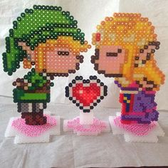Link and Zelda perler beads by  lizdejesus23 (original pattern by  geekmythologycrafts)