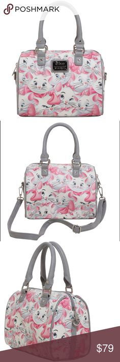 "Disney's Aristocats Marie Hand bag You need this barrel bag from Disney's The Aristocats. Why? Because you're a lady. That's why. It features a Marie print with grey trim. Inside has zipper and pouch pockets. Includes a detachable shoulder strap. Zipper closure.  10"" x 6"" x 8"" Imported brand new by Disney x Loungefly Disney Bags Satchels"