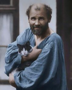 Gustav Klimt with his cat, Katze.  Austria, circa 1910.