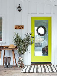 Pretty Front Porch Ideas - Eighteen25. The vibrant color of this Front Door takes this ordinary, non descript front porch up a notch that's for sure. Definitely makes you take another look..  Very nice!