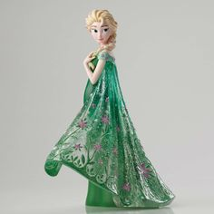 Item Number: 4051096 Material: Stone Resin Dimensions: 8 in H x 4 in W x 6.5 in L Elsa celebrates spring (and her sister's birthday) in the 2015 animated short FROZEN FEVER. Seen here, Elsa exchanges
