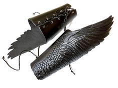 Black leather bracers Wings of shadow: a pair of hand tooled and hand painted very detailed raven wings with silver shading. Exclusive accessory for cosplay, LARP, fantasy, also for gloomy goths, brutal bikers or fans of BDSM ;) If you feel you should obtain a pair of wings for