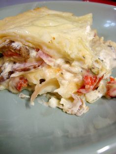 pierogi lasagna by Forkable Blog, via Flickr   Not a fan of swiss cheese, I'll use mozzarella instead.