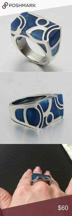 NWT Blue Chunky Ring Size 8 An exquisite ring with a gorgeous unique look. A beautiful ocean blue and stainless steel so there's no discoloration on your finger. A real head turner. Jewelry Rings
