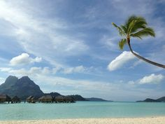 Peaceful and beautiful views at the Pearl Beach Resort & Spa in Bora Bora. Located on the west side of the island featuring overwater bungalows and garden rooms. | boraboraphotos.com