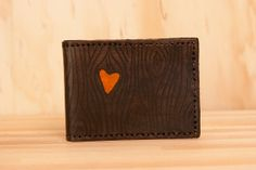 Hey, I found this really awesome Etsy listing at http://www.etsy.com/listing/100924746/nice-wallet-leather-in-orange-and